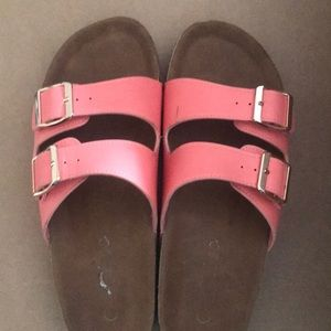 Peachy/guava colored sandals. Double buckled.